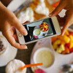 Woman taking photos of food