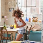 girl dancing in her kitchen