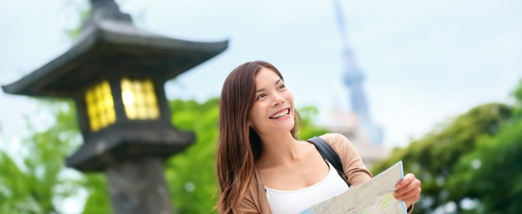 Young adult visiting the city in Japan